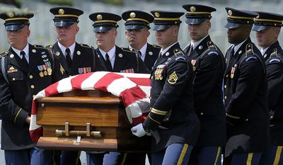 The casket of Army Pfc. David T. Miller is carried during his funeral service at Arlington National Cemetery in Arlington, Va., Wednesday, July 28, 2010. Miller was killed in Afghanistan. Miller of Wilton, N.Y., died June 21 in Afghanistan. (AP Photo/Susan Walsh)