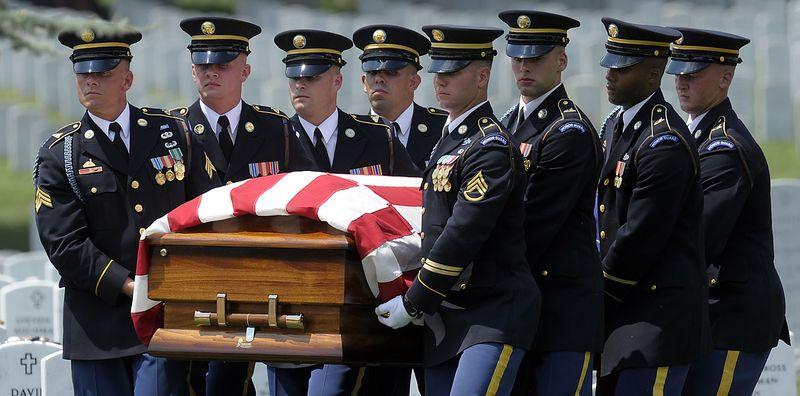 The casket of Army Pfc. David T. Miller is carried during his funeral service at Arlington National Cemetery in Arlington, Va., Wednesday, July 28, 2010. Miller was killed in Afghanistan. Miller of Wilton, N.Y., died June 21 in Afghanistan. (AP Photo/Susan Walsh)