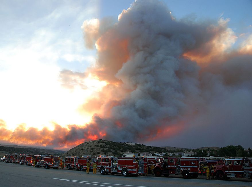 Engine companies line up along Lake Elizabeth Road at dusk Thursday, July 29, 2010. The fire, one of two major fires to break out in the same area of California, has roared through at least a thousand acres. (AP Photo/Mike Meadows)