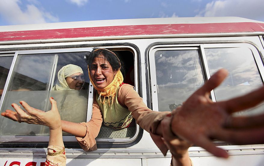Daughter of Mohammad Asim, a civilian killed in a protest, wails inside an ambulance outside a local hospital in Srinagar, India, Friday, July 30, 2010. Paramilitary soldiers fired on hundreds of demonstrators in Indian Kashmir on Friday, killing two men and wounding at least 12 others, police said as protests against Indian rule spread across the region. (AP Photo/Dar Yasin)