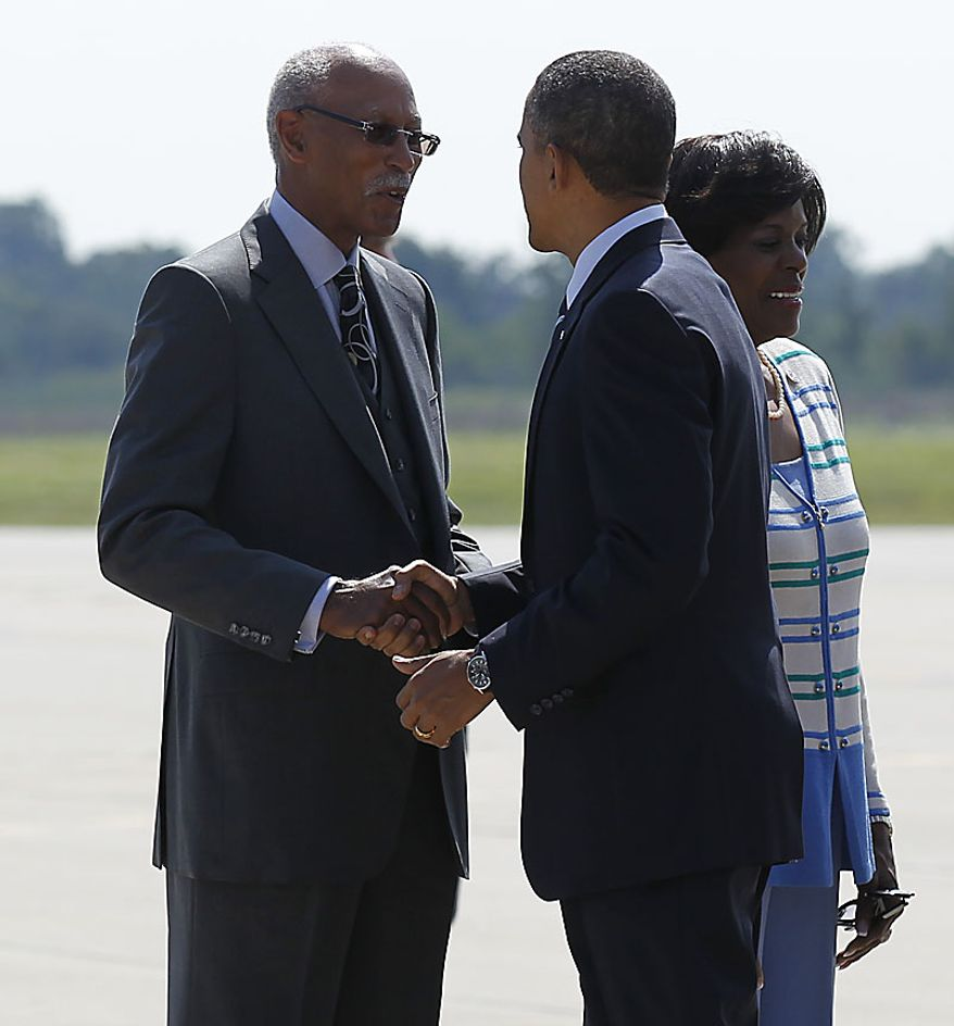 Detroit Mayor Dave Bing greets President Barack Obama upon his arrival at Detroit Wayne County Airport in Detroit, Friday, July 30, 2010. At right is Rep. Carolyn Kilpatrick, D-Mich. (AP Photo/Pablo Martinez Monsivais)