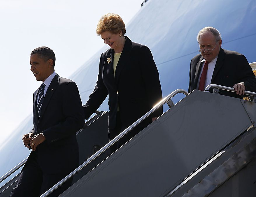 President Barack Obama, followed by Sen. Debbie Stabenow, D-Mich., and Sen. Carl Levin, D-Mich.,  arrive at Detroit Wayne County Airport in Detroit, Friday, July 30, 2010. (AP Photo/Pablo Martinez Monsivais)