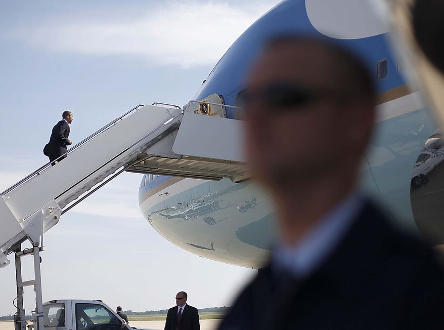 President Barack Obama boards Air Force One at Andrews Air Force Base, Md., Friday, July, 30, 2010. (AP Photo/Pablo Martinez Monsivais)