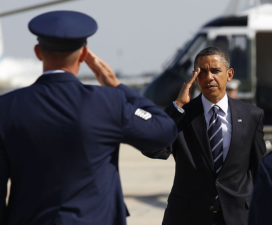 President Barack Obama salutes prior to boarding Air Force One, before his departure from Andrews Air Force Base, Md., Friday, July, 30, 2010. (AP Photo/Pablo Martinez Monsivais)