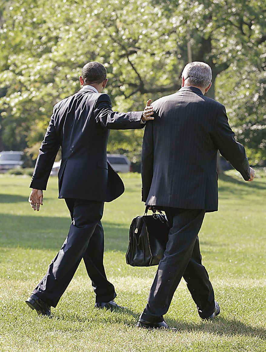 President Barack Obama and Transportaion Secretary Ray LaHood walk on the South Lawn of the White House in Washington, Friday, July 30, 2010, prior to boarding his helicopter for a short flight to Andrews Air Force Base, then on to Michigan where he will tour General Motors and Chrysler factories recovering from the financial crisis.  (AP Photo/J. Scott Applewhite)