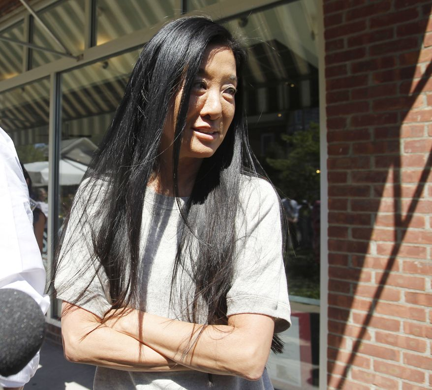 Designer Vera Wang stands outside a restaurant in Rhinebeck, N.Y., on Saturday, July 31, 2010. Chelsea Clinton and fiance Marc Mezvinsky are expected to be married in Rhinebeck today. (AP Photo/Mike Groll)