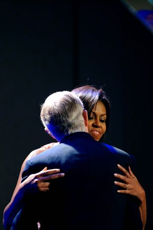 Associated Press First lady Michelle Obama hugs Senate Majority Leader Harry Reid of Nevada during an appearance in Reno. Though she says she's not a political animal, Democrats are hoping Mrs. Obama's kind words and popularity will help them win elections this fall.