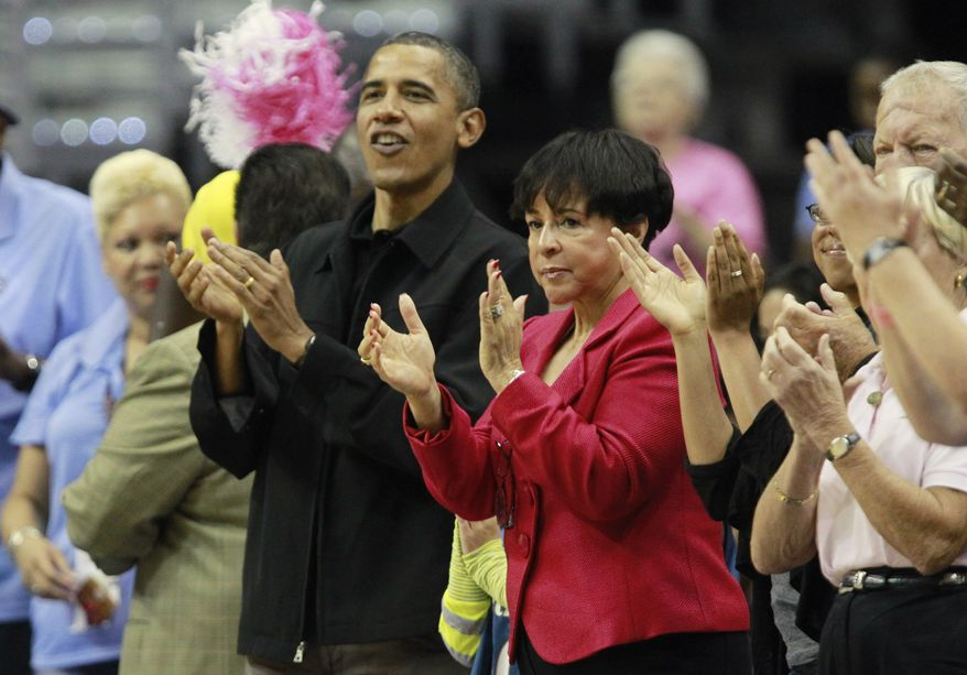 ASSOCIATED PRESS President Barack Obama, left, and Washington Mystics part owner Sheila Johnson, center right, applaud as the WNBA game between the Washington Mystics and Tulsa Shock begins Sunday, Aug. 1, 2010, in Washington.