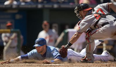 ASSOCIATED PRESS Kansas City Royals' Alex Gordon, right, is tagged out at home by Baltimore Orioles catcher Jake Fox as he tried to score on a single by Gregor Blanco during the sixth inning of a baseball game Sunday, Aug. 1, 2010, in Kansas City, Mo.