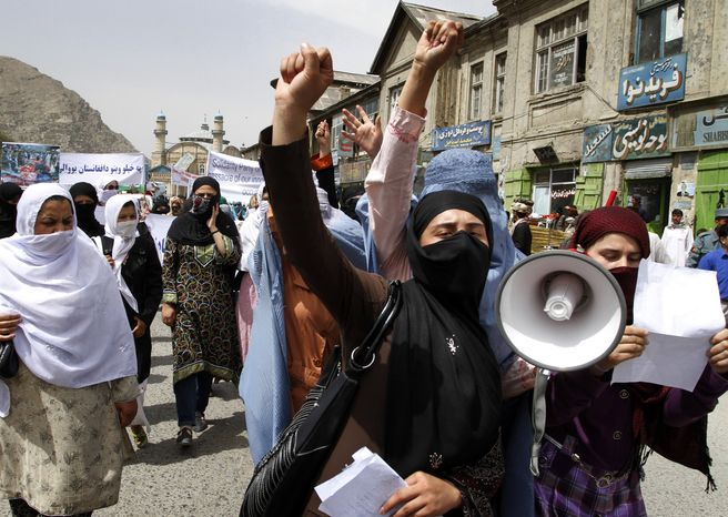 Afghan women chant slogans against NATO and U.S. forces during a demonstration in Kabul, Afghanistan, on Sunday, Aug. 1, 2010, in condemnation of the alleged killing of Afghan civilians by NATO and U.S. forces in Afghanistan. (AP Photo/Musadeq Sadeq)