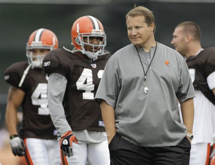 Cleveland Browns quarterback Jake Delhomme signals a play during the opening day of Browns NFL training camp in Berea, Ohio on Saturday, July 31, 2010.  (AP Photo/Amy Sancetta)