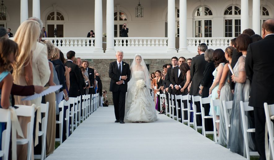 Former President Bill Clinton walks his daughter, Chelsea, down the aisle at her wedding to Marc Mezvinsky on Saturday, July 31, 2010, in Rhinebeck, N.Y. (AP Photo/Genevieve de Manio Photography, Genevieve de Manio)