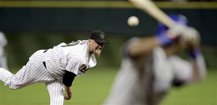 Houston Astros pitcher Brett Myers (39) delivers a pitch to Chicago Cubs' Tyler Colvin during the sixth inning of a baseball game Tuesday, July 27, 2010 in Houston. (AP Photo/David J. Phillip)