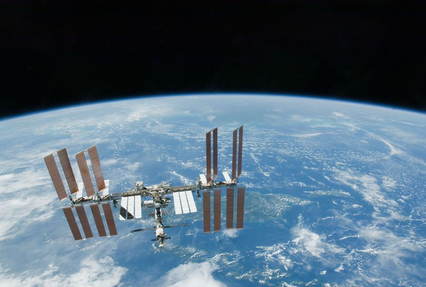 ** FILE ** Earth's horizon is a backdrop for the International Space Station, photographed in February 2010. (AP Photo/NASA, File)