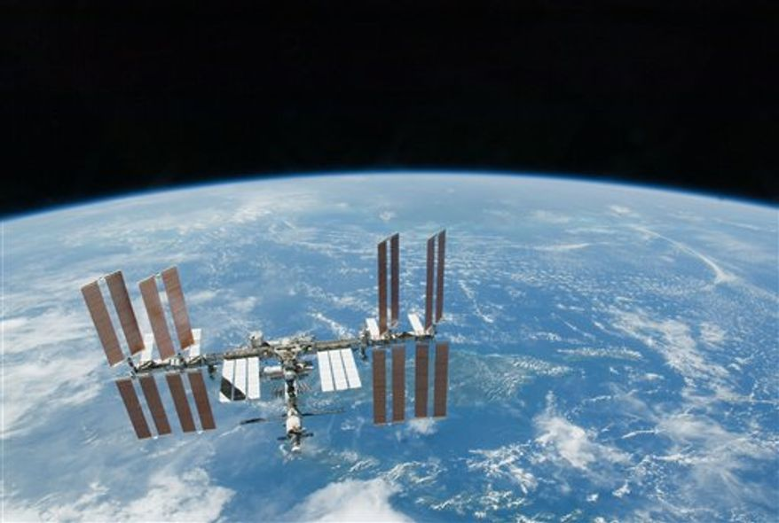 FILE - This Feb. 19. 2010 file photo provided by NASA shows the International Space Station with Earth's horizon as a backdrop. Several power systems have been shut down aboard the International Space Station after a cooling system malfunctioned. NASA says in a posting on its website that one of two cooling loops aboard the space station was shut down Saturday, July 31, 2010. A module that pumps ammonia coolant to prevent equipment from overheating was still shut down early Sunday, Aug. 1. (AP Photo/NASA, File)