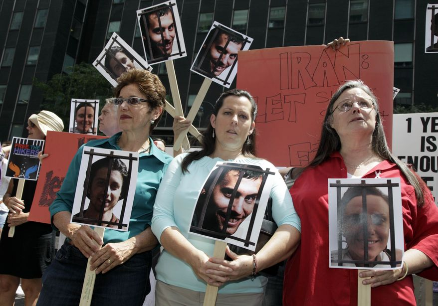 The mothers of three American hikers jailed in Iran -- (from left) Laura Fattal, Cindy Hickey and Nora Shourd -- participate in a demonstration outside Iran's mission to the United Nations in New York on Friday, July 30, 2010. Saturday marked a year since the hikers were arrested along the Iraqi border. (AP Photo/Richard Drew)