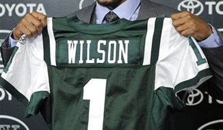 FILE - In this April 23, 2010, file photo, New York Jets first-round draft pick Kyle Wilson holds up a Jets jersey during an NFL football news conference in Florham Park, N.J.  Wilson, who played cornerback for Boise State, was the 29th overall pick and according to a  person familiar with the deal tells The Associated Press that the Jets have signed Wilson to a five-year contract worth $13 million. (AP Photo/Bill Kostroun, File)
