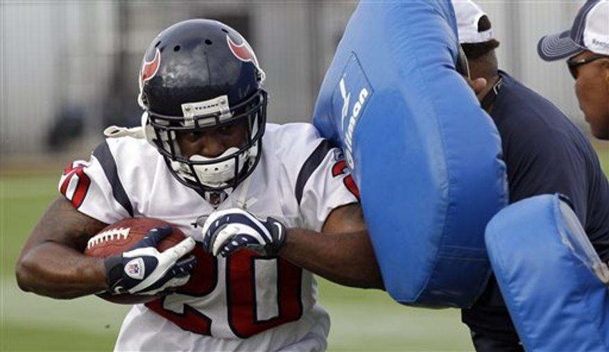 Houston Texans running back Steve Slaton (20) carries the ball during NFL football training camp, Saturday, July 31, 2010 in Houston. (AP Photo/David J. Phillip)