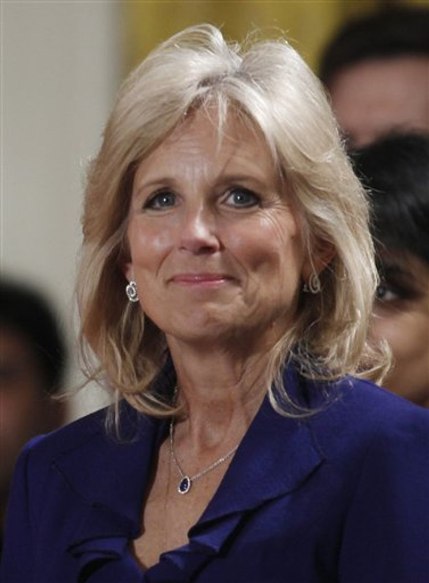 """FILE - In this Nov. 24, 2009 file photo, Jill Biden, wife of Vice President Joe Biden is shown during a State Arriva for India's Prime Minister Manmohan Singh in the East Room of the White House in Washington. Biden will play herself in an upcoming episode of Lifetime network's """"Army Wives"""" when she visits the show's Fort Marshall to hear about the challenges facing military families and offer them words of encouragement. (AP Photo/Charles Dharapak, file)"""