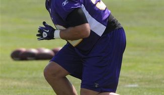 Minnesota Vikings linebacker Chad Greenway works out during the NFL football team's training camp Sunday, Aug. 1, 2010, in Mankato, Minn. (AP Photo/Jim Mone)