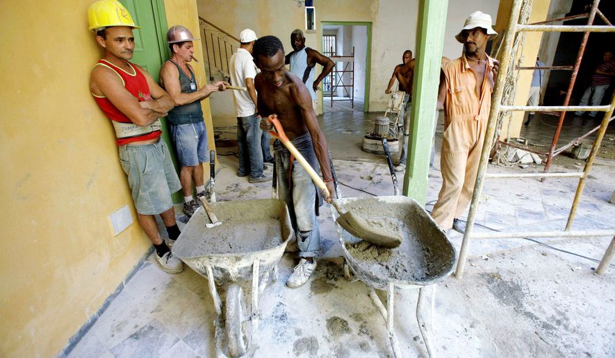 Low pay means low productivity in communist Cuba, where the state employs 95 percent of the official work force. Now, facing a severe budget deficit, President Raul Castro has hinted at restructuring or pruning the government payroll. (Associated Press)
