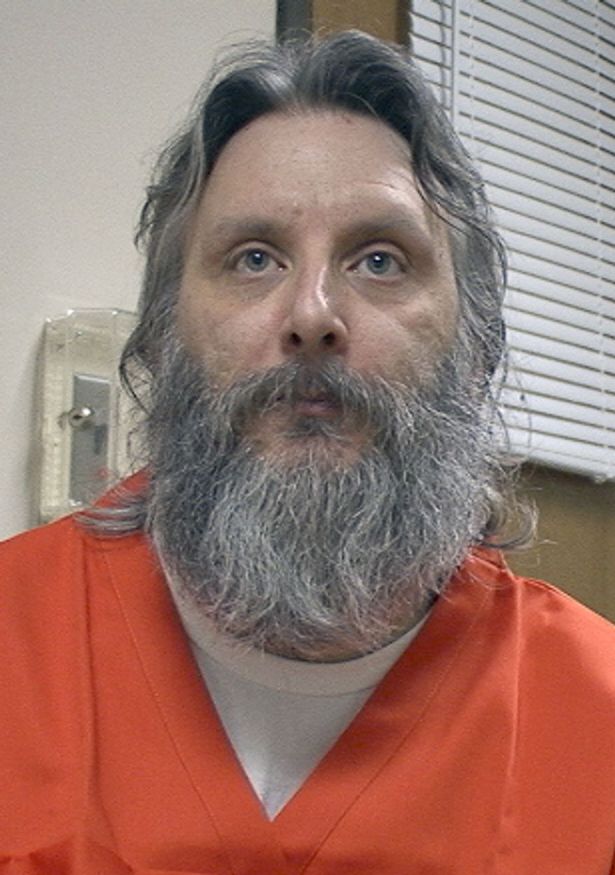 ** FILE ** In this May 26, 2010 file photo provided by Ernie Benko, death row inmate Robert Gleason meets with his defense team in the Wise County courthouse in Wise, Va. Gleason, who warned prosecutors he would kill again if not given the death penalty for strangling his former cellmate, is connected with the death of another inmate, authorities said. (AP Photo/Ernie Benko, file)