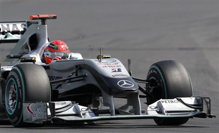 Mercedes GP Formula One driver Michael Schumacher of Germany drives his car during the Hungarian Formula One Grand Prix at the Hungaroring circuit outside Budapest, Hungary, Sunday, Aug. 1, 2010. (AP Photo/Bela Szandelszky)
