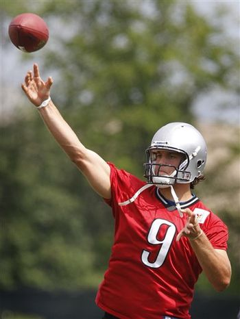 Detroit Lions quarterback Matthew Stafford (9) practices with teammate Drew Stanton (5) during football camp at their training facility in Allen Park, Mich., Monday, Aug. 2, 2010. Stafford is the undisputed starting quarterback for the Lions, unlike this time a year ago when he was competing with Daunte Culpepper for the job. (AP Photo/Carlos Osorio)
