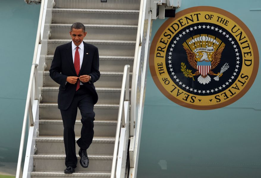 President Obama exits Air Force One at Dobbins Air Reserve Base in Marietta, Ga., Monday, Aug. 2, 2010, before speaking at the Disabled American Veterans National Convention in Atlanta. (AP Photo/Stephen Morton)