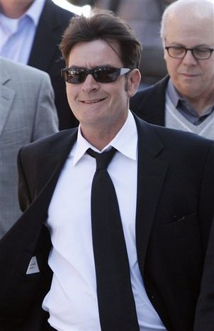 FILE - In this Jan. 28, 2009 file photo, actor Charlie Sheen is interviewed at an event to celebrate Planet Hollywood's purchase of Italian restaurant chain Buca di Beppo, at Universal CityWalk in Los Angeles. (AP Photo/Chris Pizzello, File)