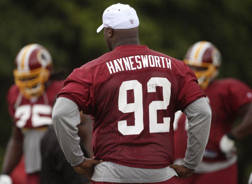 ASSOCIATED PRESS Washington Redskins' Albert Haynesworth watches his teammates workout at the NFL football team's training camp at Redskins Park, Monday, Aug. 2, 2010, in Ashburn, Va.