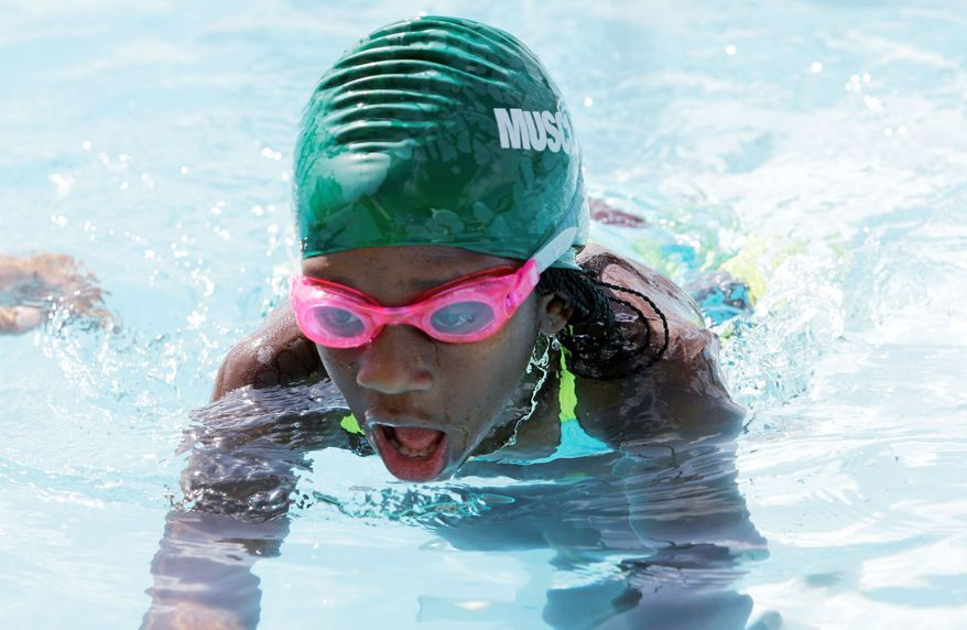 Maggie Berry, 9, practices at Swim Gym in Key Biscayne. Maggie is one of the students learning how to swim as part of an outreach program. (Associated Press)