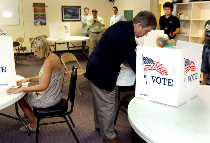 Rep. Roy Blunt votes in the Missouri primary election at Glenstone Baptist Church in Springfield, Mo., on Tuesday. Mr. Blunt is the heavy Republican favorite to win his party's nomination to replace retiring Sen. Christopher S. Bond in November's general election. (AP Photo)