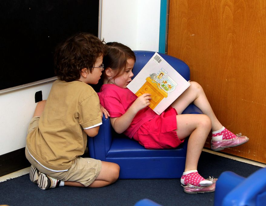 Pre-K students read at the Walden Early Childhood Center in Atlanta. States are cutting millions from their pre-kindergarten budgets, undermining years of helping children get ready for school. (Associated Press)