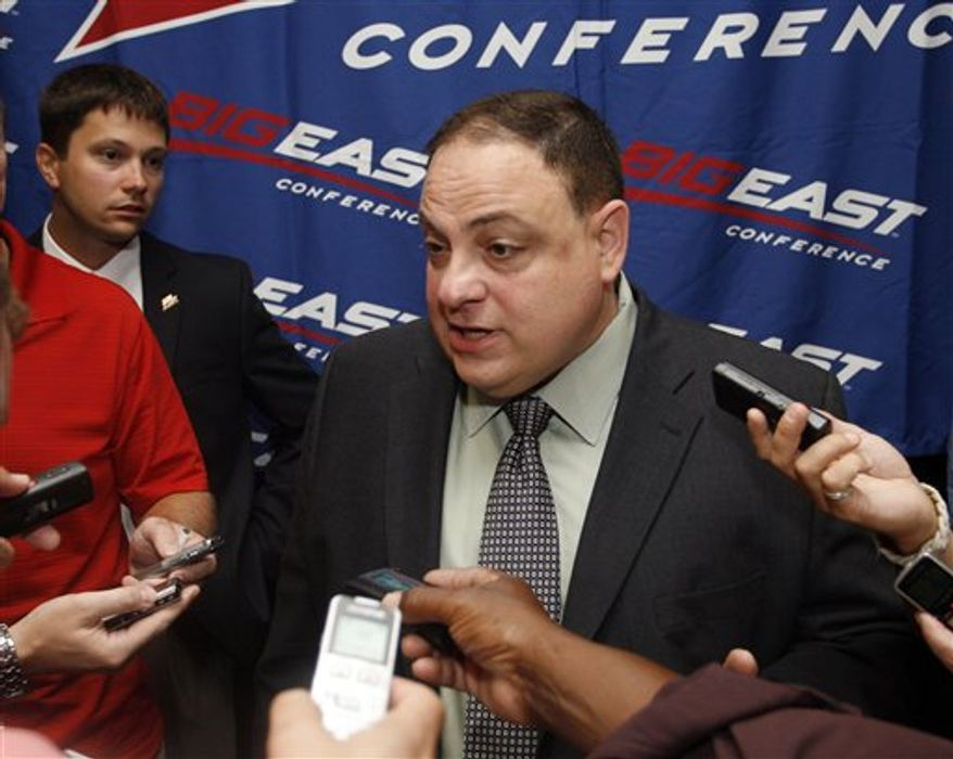 Big East football commissioner John Marinatto speaks with the media during the Big East Football media day, Tuesday, Aug. 3, 2010, in Newport, R.I. (AP Photo/Stew Milne)