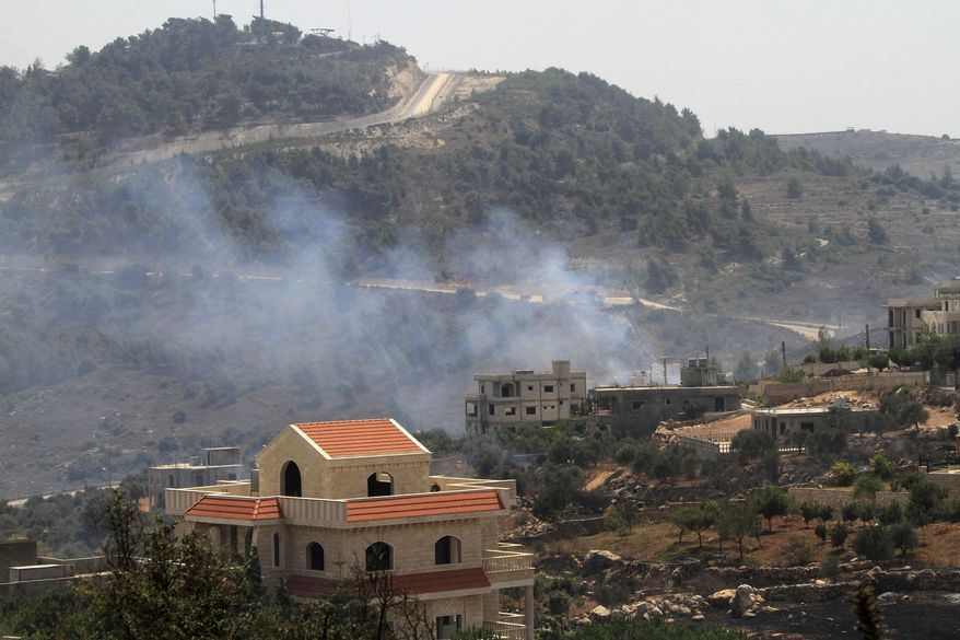 Smoke rises from the southern border village of Adaisseh after an exchange of fire between Israeli and Lebanese troops along the border between Israel and Lebanon, Tuesday, Aug. 3, 2010. Lebanon and Israeli troops exchanged fire on the border Tuesday in the most serious clashes since a fierce war four years ago. (AP Photo/Mohammed Zaatari)