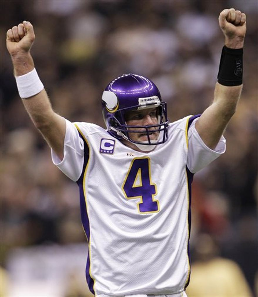 FILE - This Jan. 24, 2010, file photo shows Minnesota Vikings quarterback Brett Favre (4) celebrating his touchdown pass to Sidney Rice during the first quarter of the NFC Championship NFL football game against the New Orleans Saints, in New Orleans. A person with knowledge of the situation tells The Associated Press that Brett Favre has informed the Vikings he will not return to Minnesota for a second season. The person spoke on condition of anonymity Tuesday, Aug. 3, 2010,  because the team had not made an official announcement. (AP Photo/David J. Phillip, File)