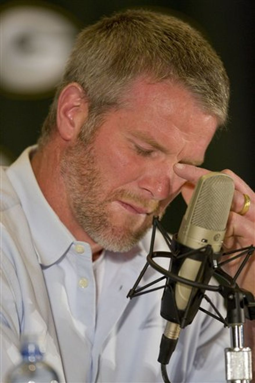 FILE - In this March 6, 2008 photo, Green Bay Packers quarterback Brett Favre gets choked up as he talks about his retirement during a news conference at Lambeau Field in Green Bay, Wis.  A person with knowledge of the situation tells The Associated Press that Brett Favre has informed the Vikings he will not return to Minnesota for a second season. The person spoke on condition of anonymity Tuesday, Aug. 3, 2010,  because the team had not made an official announcement.  (AP Photo/Mike Roemer)