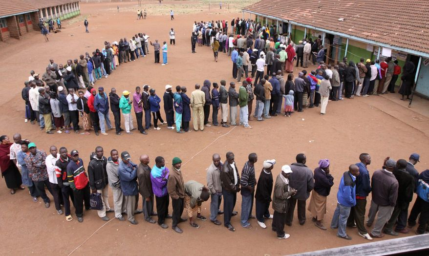 Kenyans wait to cast their votes during the referendum for Kenya's new constitution in Nairobi on Wednesday. Lines formed before sunrise to vote on a measure that would reduce the powers of the president and give citizens a bill of rights. (Associated Press)