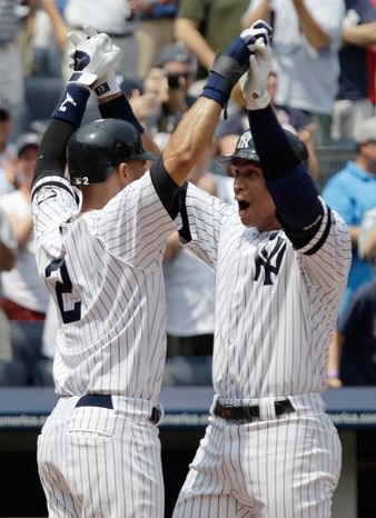 New York Yankees' Alex Rodriguez, right, is congratulated at home plate by Derek Jeter after hitting his 600th career home run during the first inning of a baseball against the Toronto Blue Jays at Yankee Stadium on Wednesday, Aug. 4, 2010 in New York. (AP Photo/Kathy Willens)
