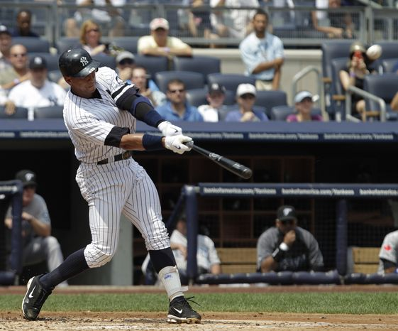 New York Yankees' Alex Rodriguez connects for his 600th career home run during the first inning of a baseball game against the Toronto Blue Jays at Yankee Stadium on Wednesday, Aug. 4, 2010 in New York. (AP Photo/Kathy Willens)