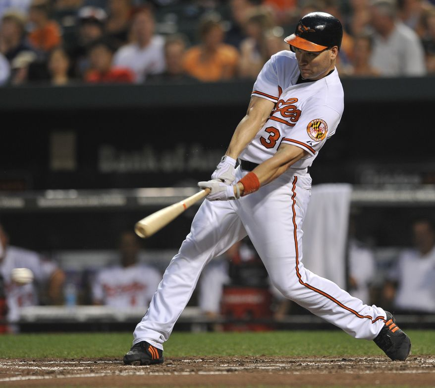 ASSOCIATED PRESS Baltimore Orioles' Luke Scott on a single against the Los Angeles Angels during the third inning of a baseball game Wednesday, Aug. 4, 2010, in Baltimore.