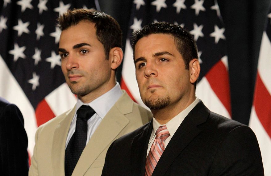 Paul Katami (left) and Jeff Zarrillo appear at a news conference in San Francisco on Wednesday. Mr. Katami and Mr. Zarrillo were one of the two same-sex couples who were plaintiffs in a federal court case on California's same-sex marriage ban. (Associated Press)