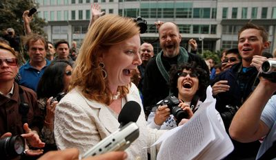 Molly McKay of Marriage Equality USA reacts while reading a copy of a federal judge's decision overturning California's same-sex marriage ban in San Francisco on Wednesday. Judge Walker made his ruling in a lawsuit filed by two gay couples who claimed the voter-approved ban violated their civil rights. (Associated Press)