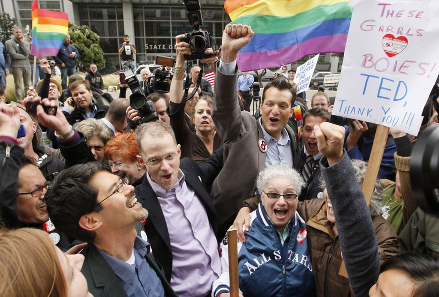 Opponents of Proposition 8 cheer Wednesday after hearing the decision in the U.S. District Court proceedings challenging Proposition 8 outside of the Phillip Burton Federal Building in San Francisco. A federal judge overturned California's same-sex marriage ban in a landmark case that could eventually land before the U.S. Supreme Court to decide if gays have a constitutional right to marry in America. (Associated Press)