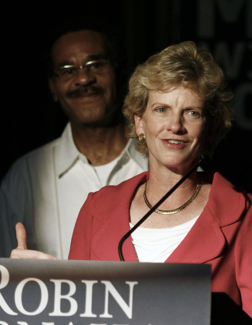 Missouri Secretary of State Robin Carnahan (front) speaks to supporters during an election-night party after she won the Democratic nomination for the U.S. Senate. Rep. Emanuel Cleaver II, Missouri Democrat, stands behind her. (AP Photo/Ed Zurga)