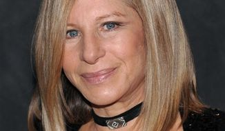 ** FILE ** In this Sept. 26, 2009, file photo, singer Barbra Streisand poses at the Waldorf-Astoria following her performance at the Village Vanguard in New York. (AP Photo/Evan Agostini, File)