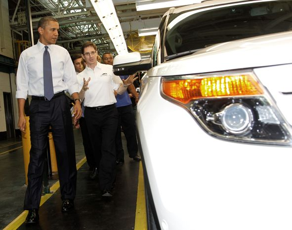 ASSOCIATED PRESS President Obama looks at the redesigned 2011 Ford Explorer SUV with Ford Chief Engineer James Holland (center) during his tour of the Ford Motor Company assembly plant in Chicago on Thursday.