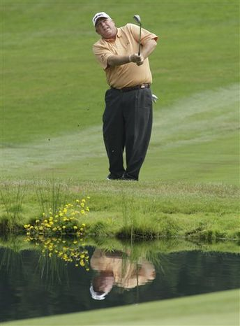 FILE - In this Friday, July 30, 2010, file photo, Mark Calcavecchia hits near a water hazard on the fifth hole during the second round of the U.S. Senior Open golf tournament at Sahalee Country Club in Sammamish, Wash. Calcavecchia is preparing this week for the 3M Championship, his fifth tournament on the 50-and-over tour. Calcavecchia's challenge now is finding the confidence and consistency he needs to stay competitive in the new environment. (AP Photo/Ted S. Warren, File)