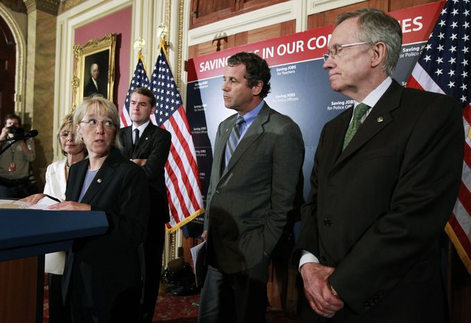 Sen. Patty Murray, Washington Democrat, second from left, glances at Senate Majority Leader Harry Reid of Nevada, right, during a press conference on Capitol Hill in Washington, Wednesday, Aug. 4, 2010, after a Senate vote that would clear the way for a $26 billion measure to help states with their severe budget problems and save the jobs of tens of thousands of teachers and other public employees . From left are, Sen. Barbara Boxer, California Democrat, Mrs. Murray, Sen. Michael Bennet, Colorado Democrat, Sen. Sherrod Brown, Ohio Democrat, and Mr. Reid. (AP Photo/Manuel Balce Ceneta)